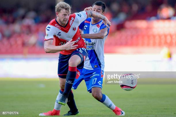 Cristian Menendez of Veracruz fights for the ball with Alonso Zamora of Puebla during the 3rd round match between Veracruz and Puebla as part of the...