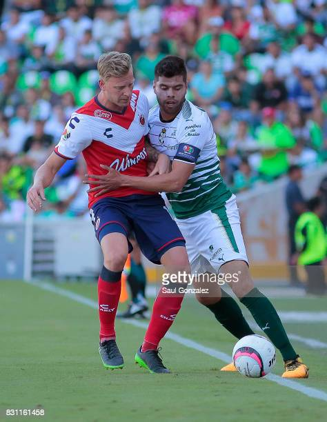 Cristian Menendez of Veracurz and Nestor Araujo of Santos fight for the ball during the 4th round match between Santos Laguna and Veracruz as part of...
