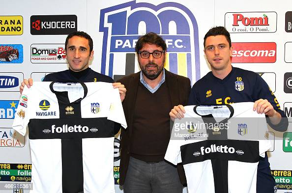 Cristian Molinaro and Nicola Pozzi new signings for Parma FC pose with the club shirt with General Manager of Parma FC Pietro Leonardi during a press...