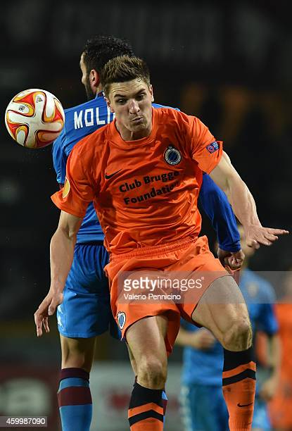 Cristian Molinaro of Torino FC clashes with Thomas Meunier of Club Brugge KV during the UEFA Europa League group B match between Torino FC and Club...