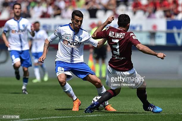 Cristian Molinaro of Torino FC tackles Matias Vecino of Empoli FC during the Serie A match between Torino FC and Empoli FC at Stadio Olimpico di...