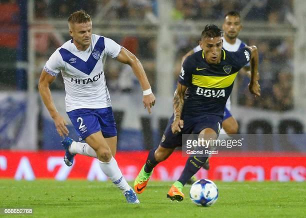 Cristian Nasuti of Velez Sarsfield fights for the ball with Ricardo Adrian Centurion of Boca Juniors during a match between Velez Sarsfield and Boca...