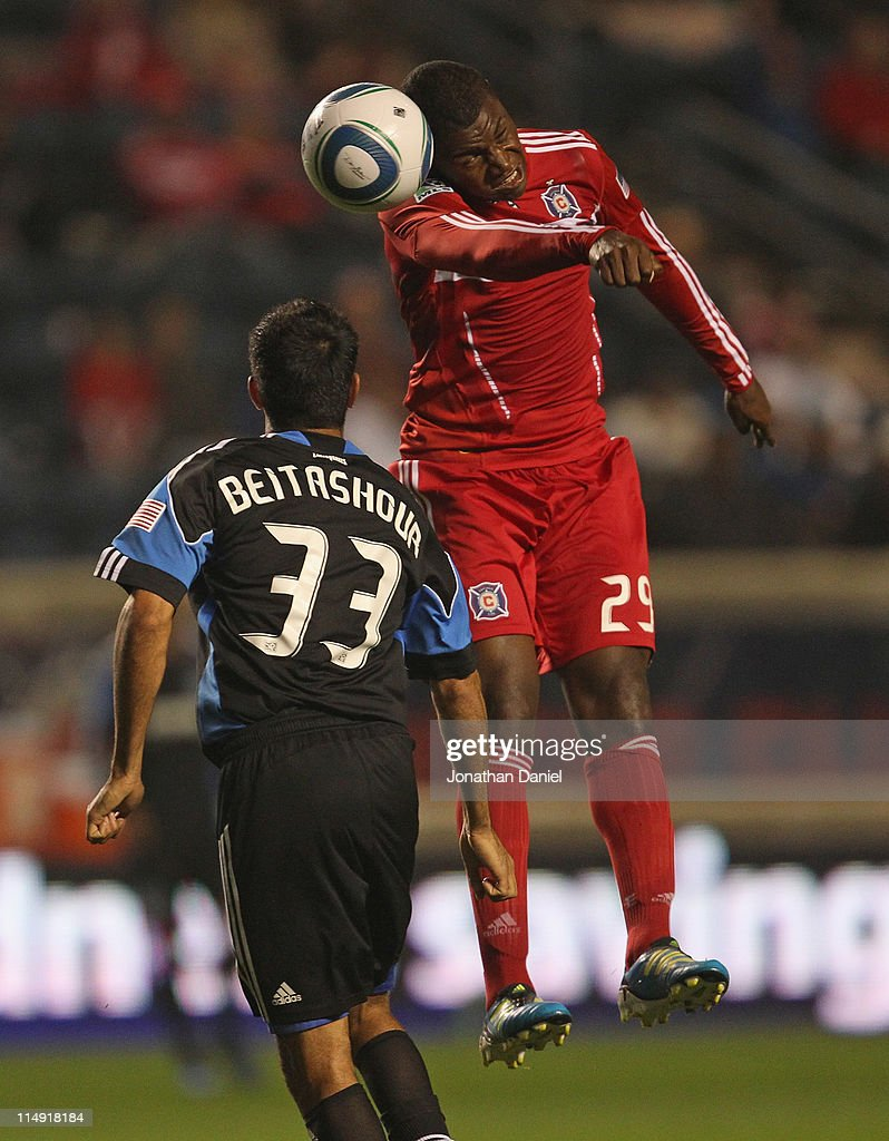 Cristian Nazarit of the Chicago Fire heads the ball past Steven Beitashour of the San Jose Earthquakes during an MLS match at Toyota Park on May 28...