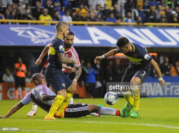Cristian Pavon and Darío Benedetto of Boca Juniors fights for the ball with Jonathan Maidana and Ariel Rojas of River Plate during the match for the...