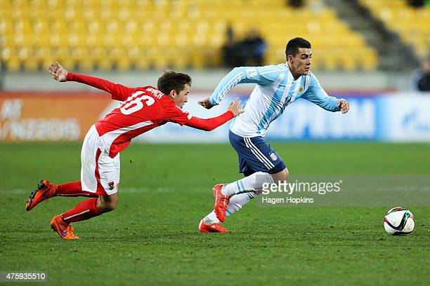 Cristian Pavon of Argentina evades Alexander Joppich of Austria during the FIFA U20 World Cup New Zealand 2015 Group B match between Austria and...