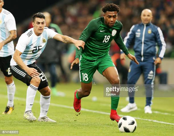 Cristian Pavon of Argentina vies for the ball with Alex Iwobi of Nigeria during the International Friendly Match between Argentina and Nigeria at...