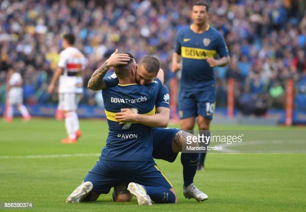 Cristian Pavon of Boca Juniors celebrates with teammate Dario Benedetto after scoring the first goal of his team during a match between Boca Juniors...
