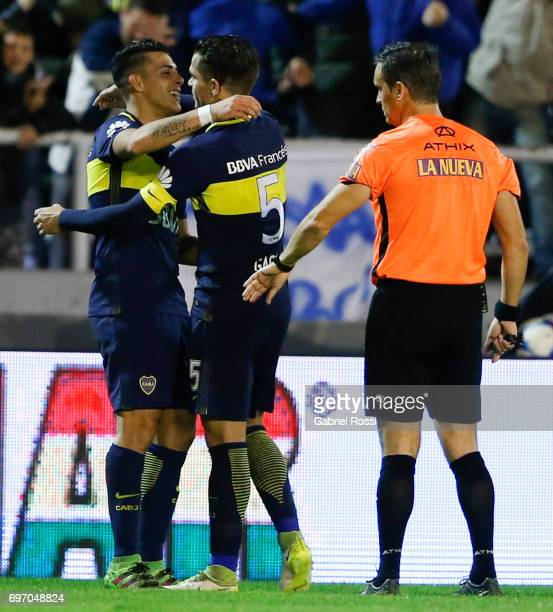 Cristian Pavon of Boca Juniors celebrates with teammate Fernando Gago after scoring the first goal of his team during a match between Aldosivi and...
