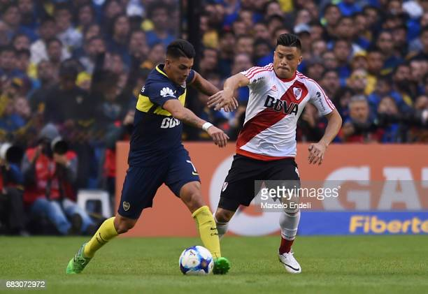 Cristian Pavon of Boca Juniors fights for ball with Jorge Moreira of River Plate during a match between Boca Juniors and River Plate as part of...