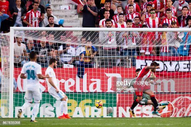 Cristian 'Portu' of Girona FC scores his team's second goal during the La Liga match between Girona and Real Madrid at Estadi de Montilivi on October...