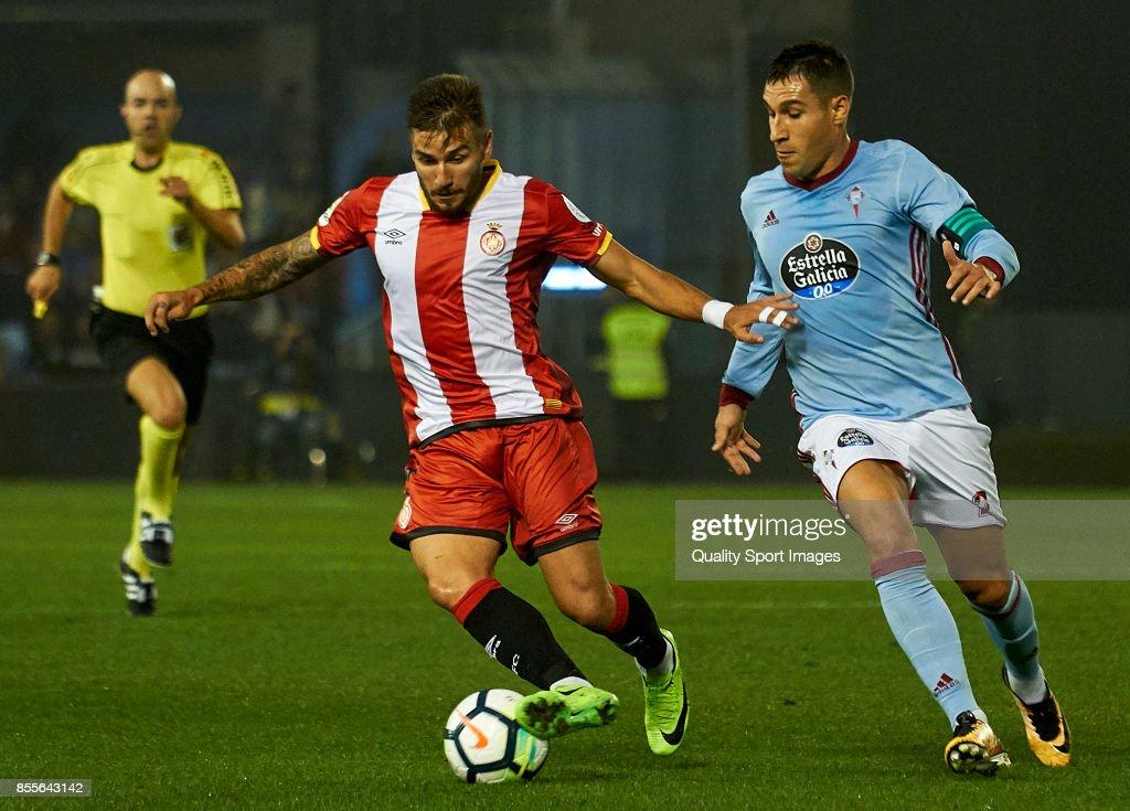 Cristian Portugues 'Portu' of Girona FC is challenged by Hugo Mallo of Celta de Vigo during the La Liga match between Celta de Vigo and Girona at Balaidos Stadium on September 29, 2017 in Vigo, Spain.
