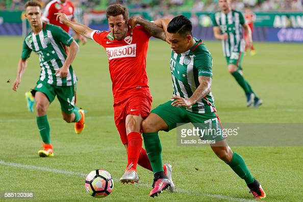 Cristian Ramirez of Ferencvarosi TC duels for the ball with Diego Vela of DVTK before Dominik Nagy of Ferencvarosi TC during the Hungarian OTP Bank...