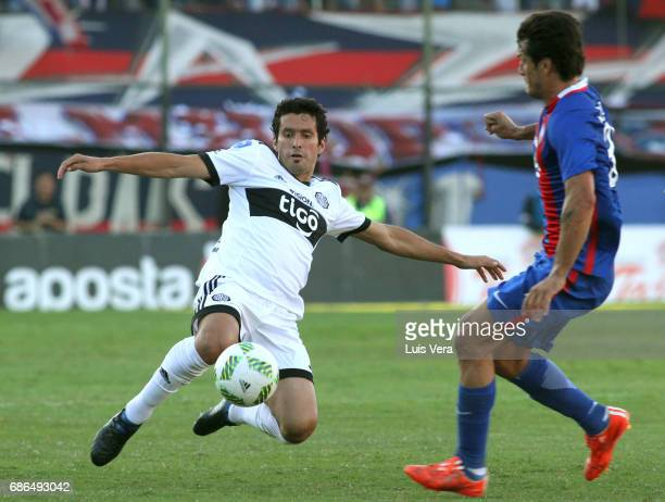 Cristian Riveros of Olimpia fights for the ball with Nelson Haedo Valdez of Cerro Porteño during a match between Olimpia and Cerro Porteño as part of...