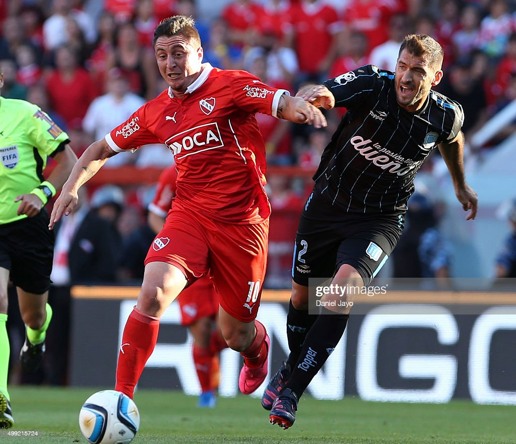 Cristian Rodriguez of Independiente (L) and <a gi-track='captionPersonalityLinkClicked' href=/galleries/search?phrase=Nicolas+Sanchez&family=editorial&specificpeople=2294479 ng-click='$event.stopPropagation()'>Nicolas Sanchez</a> of Racing Club fight for the ball during a first leg match between Independiente and Racing Club as part of Pre Copa Libertadores Playoff at Libertadores de America Stadium on November 29, 2015 in Avellaneda, Argentina.