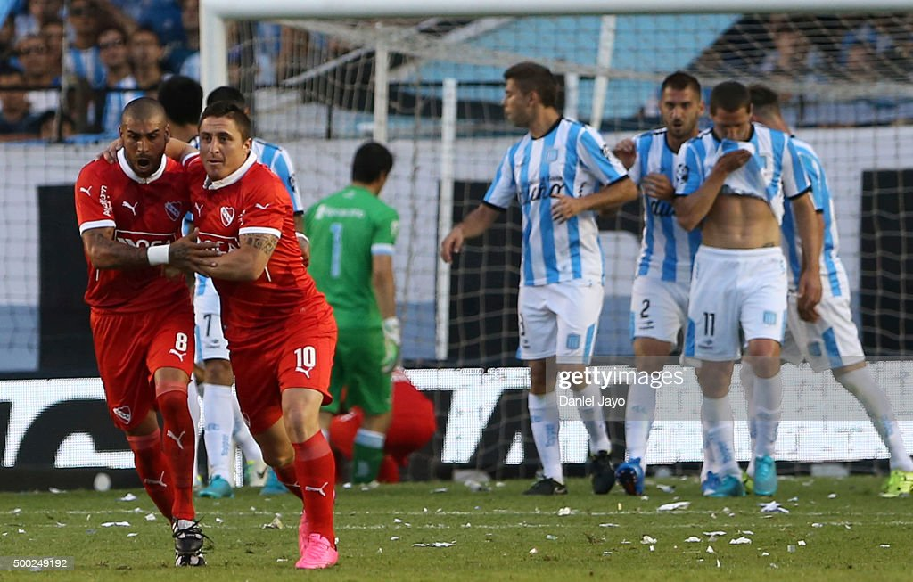 Cristian Rodriguez, of Independiente, (10) celebrates with <a gi-track='captionPersonalityLinkClicked' href=/galleries/search?phrase=Jesus+Mendez+-+Soccer+Player&family=editorial&specificpeople=7955590 ng-click='$event.stopPropagation()'>Jesus Mendez</a> after scoring the opening goal during a second leg match between Independiente and Racing Club as part of Pre Copa Libertadores Playoff at Presidente Peron Stadium on December 06, 2015 in Avellaneda, Argentina.