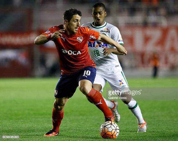 Cristian Rodriguez of Independiente fights for the ball with Matheus Biteco of Chapecoense during a first leg match between Independiente and...