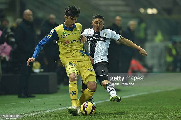 Cristian Rodriguez of Parma FC competes with Ervin Zukanovic of AC Chievo Verona during the Serie A match between Parma FC and AC Chievo Verona at...