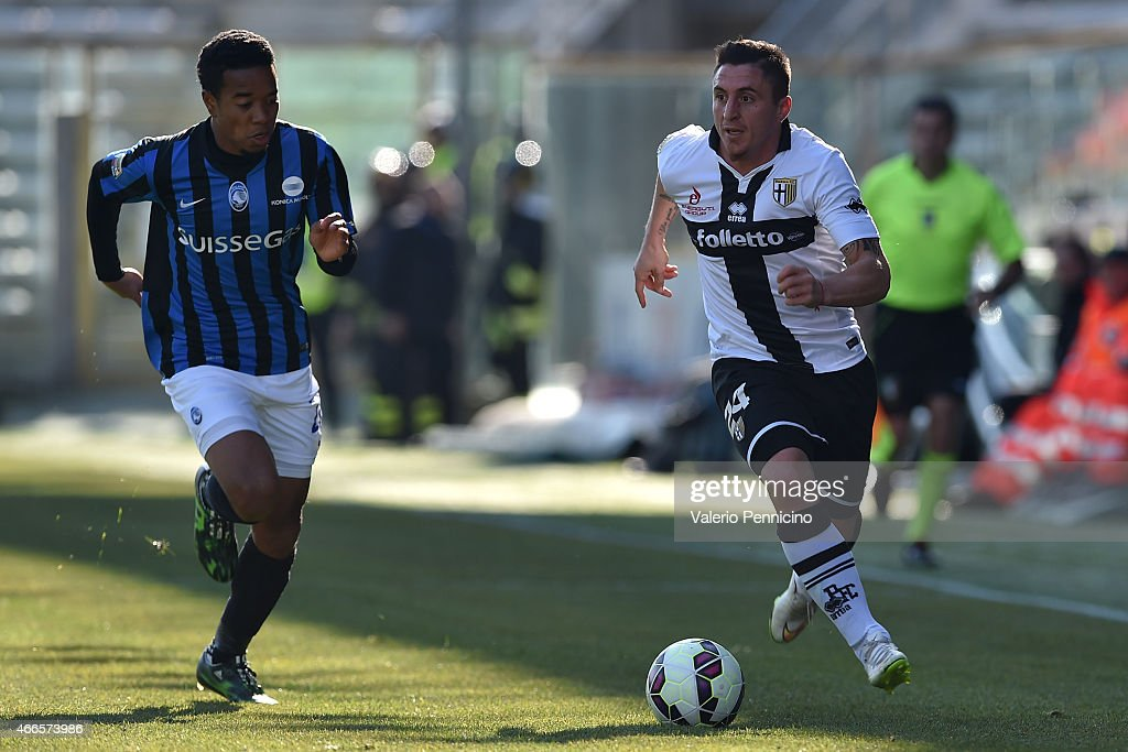 Cristian Rodriguez of Parma FC in action against Urby Emanuelson of Atalanta BC during the Serie A match between Parma FC and Atalanta BC at Stadio...
