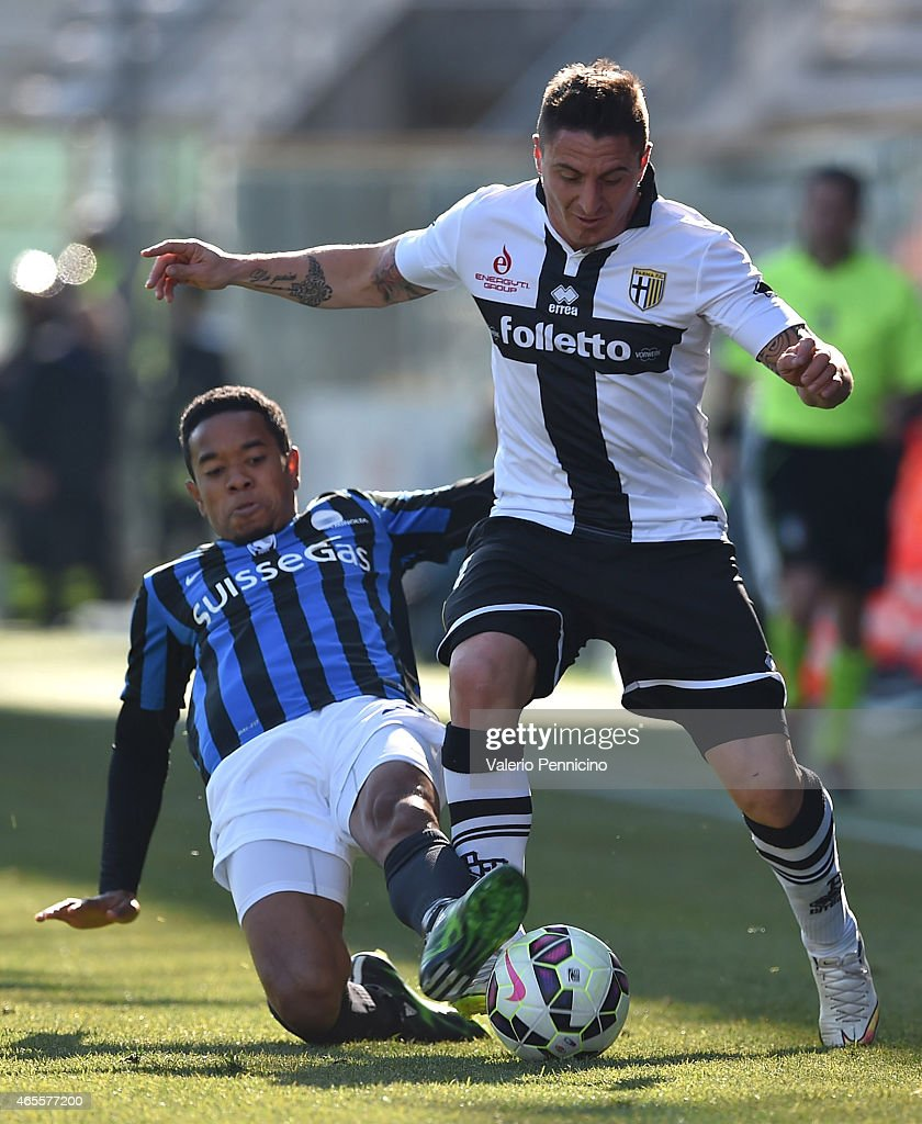 Cristian Rodriguez of Parma FC is tackled by Urby Emanuelson of Atalanta BC during the Serie A match between Parma FC and Atalanta BC at Stadio Ennio...