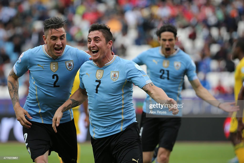 Cristian Rodriguez of Uruguay celebrates with teammate Jose Maria Gimenez after scoring the opening goal during the 2015 Copa America Chile Group B match between Uruguay and Jamaica at Regional Calvo y Bascuñan Stadium on June 13, 2015 in Antofagasta, Chile.