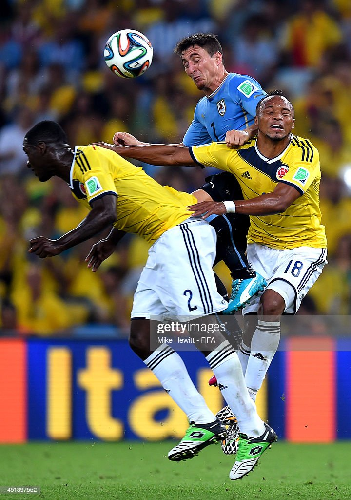 Cristian Rodriguez (C) of Uruguay competes for the ball against <a gi-track='captionPersonalityLinkClicked' href=/galleries/search?phrase=Cristian+Zapata&family=editorial&specificpeople=854055 ng-click='$event.stopPropagation()'>Cristian Zapata</a> (L) and Juan Camilo Zuniga (R) of Colombia during the 2014 FIFA World Cup Brazil Round of 16 match between Colombia and Uruguay at Maracana on June 28, 2014 in Rio de Janeiro, Brazil.