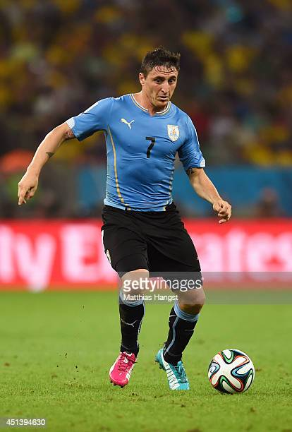 Cristian Rodriguez of Uruguay controls the ball during the 2014 FIFA World Cup Brazil round of 16 match between Colombia and Uruguay at Maracana on...