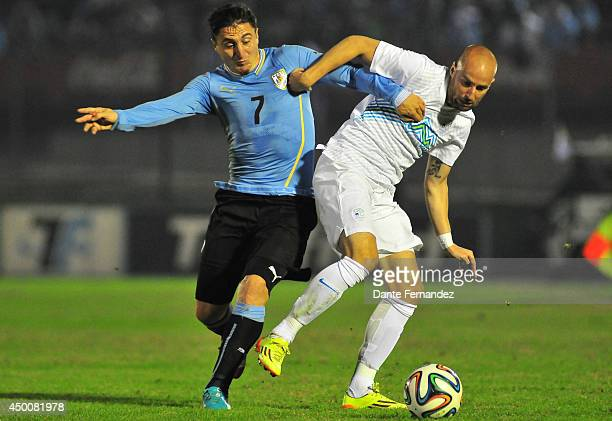 Cristian Rodriguez of Uruguay fights for the ball with Miso Brecko of Slovenia during the International friendly match between Uruguay and Slovenia...