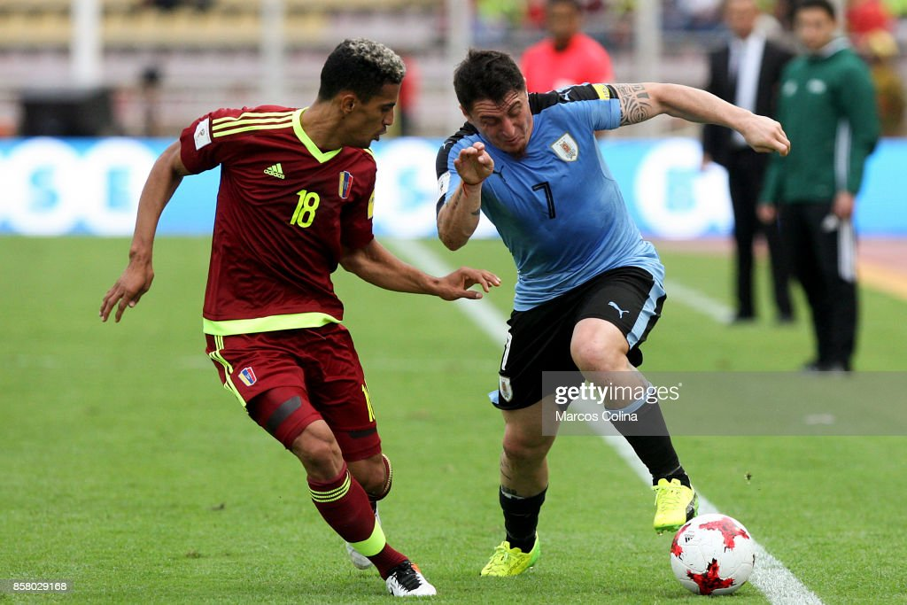 Cristian Rodriguez of Uruguay fights for the ball with Victor Garcia of Venezuela during a match between Venezuela and Uruguay as part of FIFA 2018 World Cup Qualifiers at Pueblo Nuevo Stadium on October 05, 2017 in San Cristobal, Venezuela.