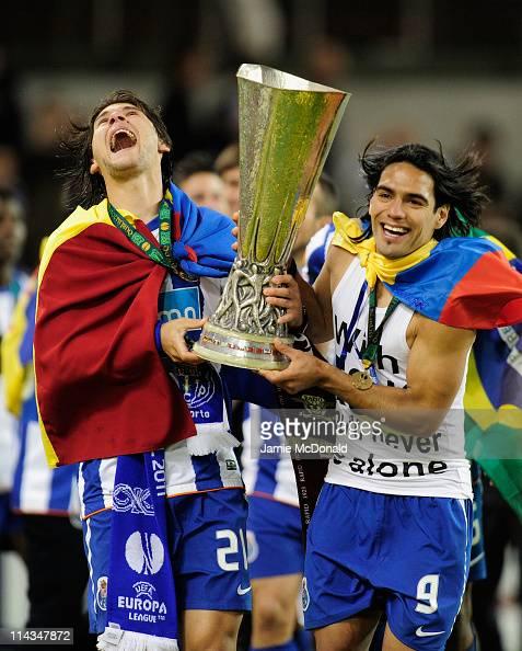 Cristian Sapunaru and Radamel Falcao Garcia of FC Porto celebrate with the trophy during the UEFA Europa League Final between FC Porto and SC Braga...