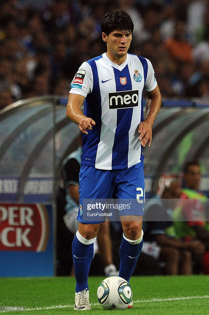 <a gi-track='captionPersonalityLinkClicked' href=/galleries/search?phrase=Cristian+Sapunaru&family=editorial&specificpeople=633831 ng-click='$event.stopPropagation()'>Cristian Sapunaru</a> of FC Porto in action during the Portuguese Primeira Liga match between FC Porto and Gil Vicente FC held on August 19, 2011 at the Dragao Stadium in Porto, Portugal.