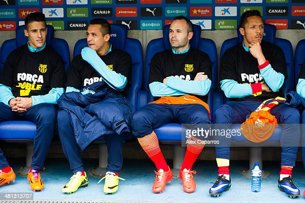 Cristian Tello Alexis Sanchez Andres Iniesta and Adriano Correia of FC Barcelona look on on the bench during the La Liga match between RCD Espanyol...