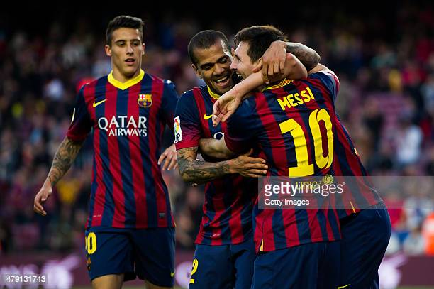 Cristian Tello Daniel Alves and Lionel Messi of FC Barcelona celebrate after his teammate Pedro Rodriguez scored his team's seventh goal during the...