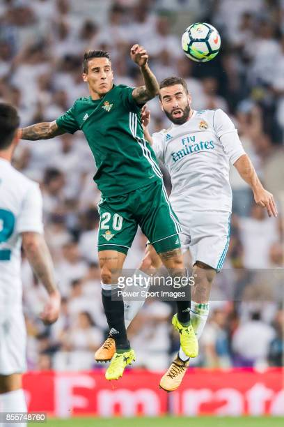 Cristian Tello Herrera of Real Betis fights for the ball with Daniel Carvajal Ramos of Real Madrid during the La Liga 201718 match between Real...