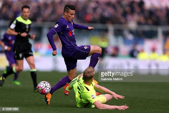 Cristian Tello of ACF Fiorentina battles for the ball with Filip Helander of Hellas Verona FC during the Serie A match between ACF Fiorentina and...