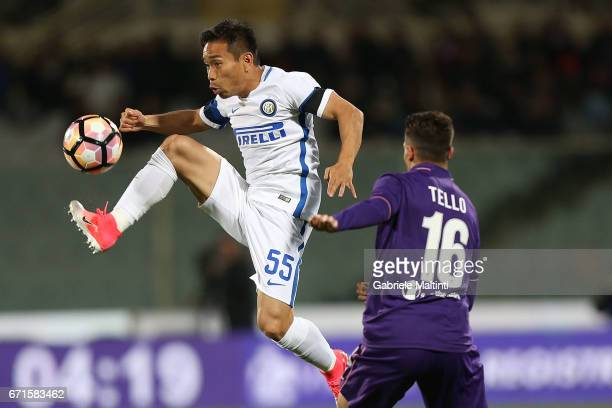 Cristian Tello of ACF Fiorentina battles for the ball with Iuto Nagatomo of FC Internazionale during the Serie A match between ACF Fiorentina v FC...