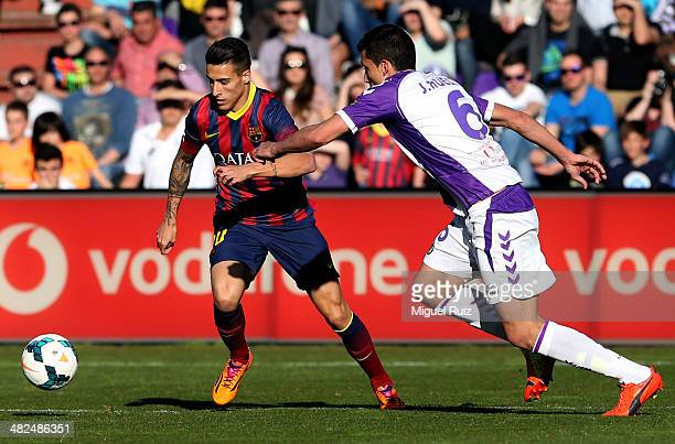 Cristian Tello of FC Barcelona competes for the ball with Jesus Rueda of Real Valladolid CF during La Liga match 27 between Real Valladolid CF and FC...