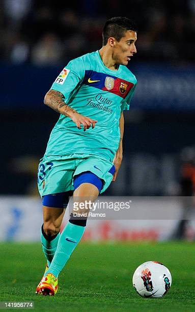 Cristian Tello of FC Barcelona runs with the ball during the La Liga match between RCD Mallorca and FC Barcelona at Iberostar Stadium on March 24...