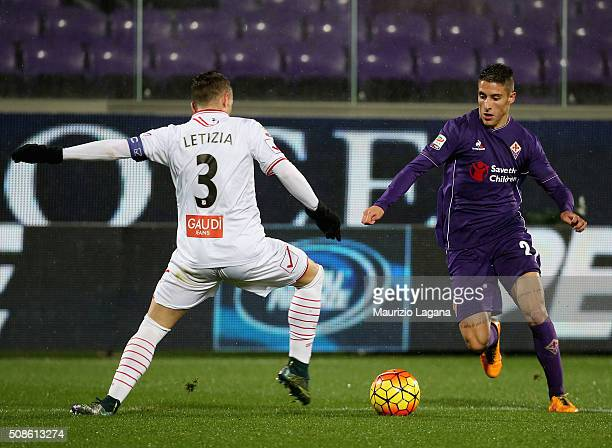 Cristian Tello of Fiorentina competes for the ball with Gaetano Letizia of Carpi during the Serie A match between ACF Fiorentina and Carpi FC at...
