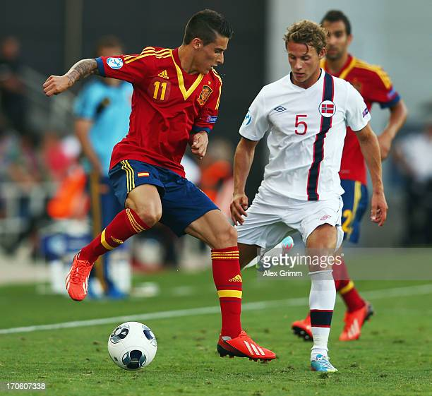 Cristian Tello of Spain is challenged by Vegar Eggen Hedenstad of Norway during the UEFA European U21 Championship Semi Final match between Spain and...