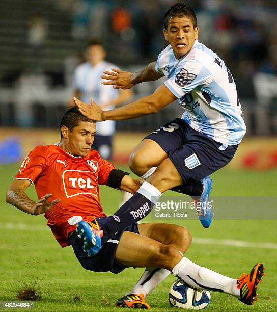 Cristian Tula of Independiente fights for the ball with Luis Iba–ñez of Racing Club during a match between Racing Club and Independiente as part of...