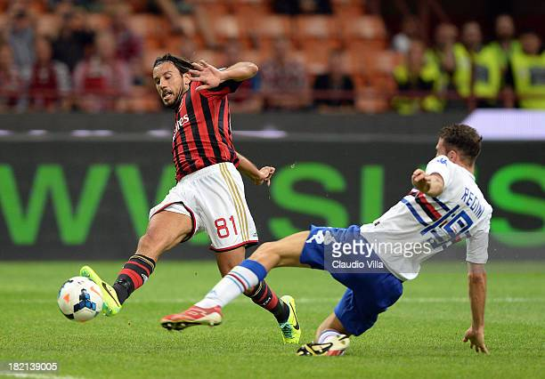 Cristian Zaccardo of AC Milan and Vasco Regini of UC Sampdoria compete for the ball during the Serie A match between AC Milan and UC Sampdoria at...