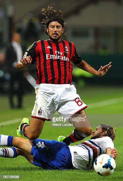 Cristian Zaccardo of AC Milan competes for the ball with Andrea Costa of UC Sampdoria during the Serie A match between AC Milan and UC Sampdoria at...
