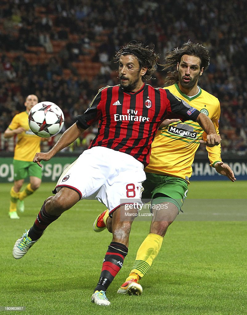 <a gi-track='captionPersonalityLinkClicked' href=/galleries/search?phrase=Cristian+Zaccardo&family=editorial&specificpeople=454833 ng-click='$event.stopPropagation()'>Cristian Zaccardo</a> of AC Milan competes for the ball with Giorgos Samaras of Celtic during the UEFA Champions League group H match between AC Milan and Celtic at Stadio Giuseppe Meazza on September 18, 2013 in Milan, Italy.