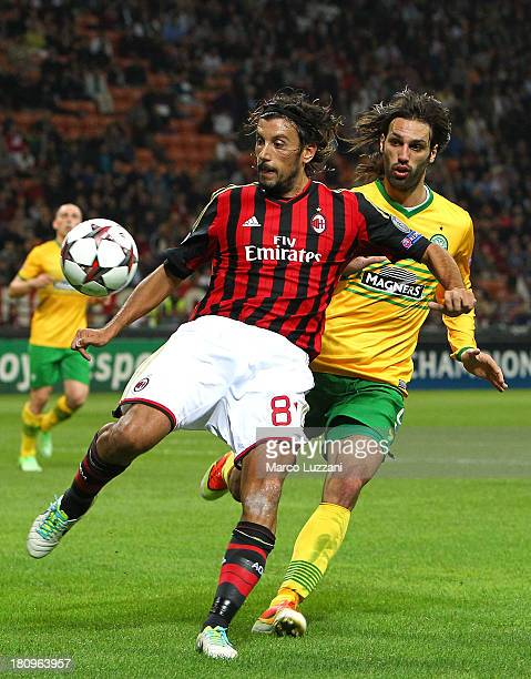 Cristian Zaccardo of AC Milan competes for the ball with Giorgos Samaras of Celtic during the UEFA Champions League group H match between AC Milan...