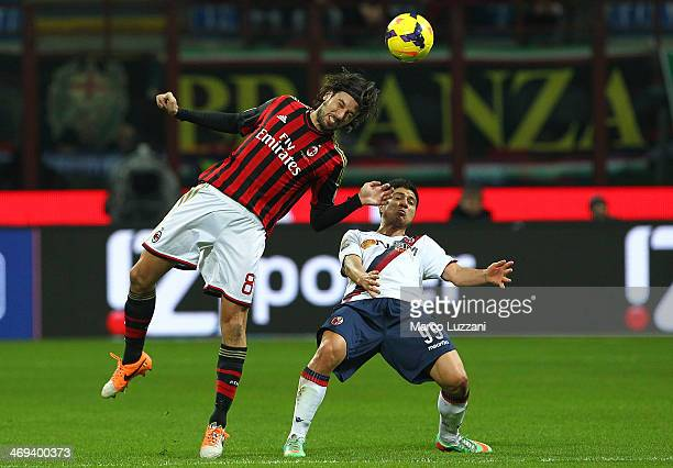 Cristian Zaccardo of AC Milan competes for the ball with Jonatan Ezequiel Cristaldo of Bologna FC during the Serie A match between AC Milan and...