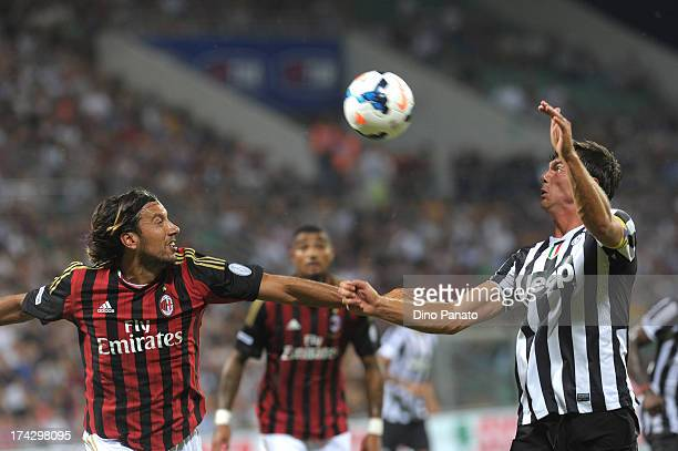 Cristian Zaccardo of AC Milan competes with Paolo de Ceglie of Juventus during the TIM Preseason Tournament between US Sassuolo Juventus and AC Milan...