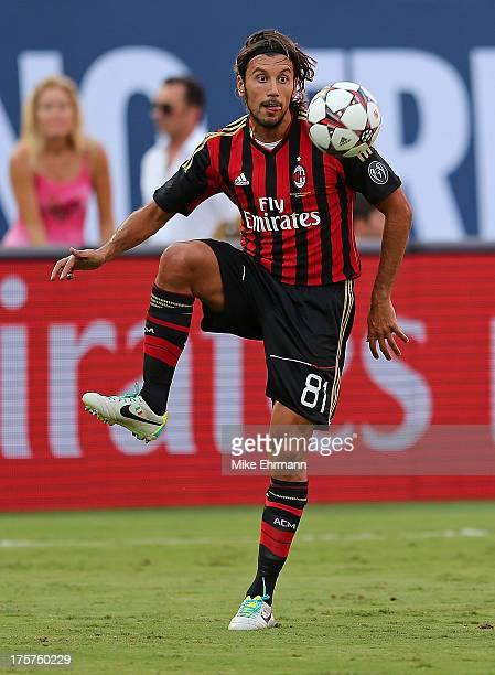 Cristian Zaccardo of AC Milan dribbles during the International Champions Cup Third Place Match against the Los Angeles Galaxy at Sun Life Stadium on...
