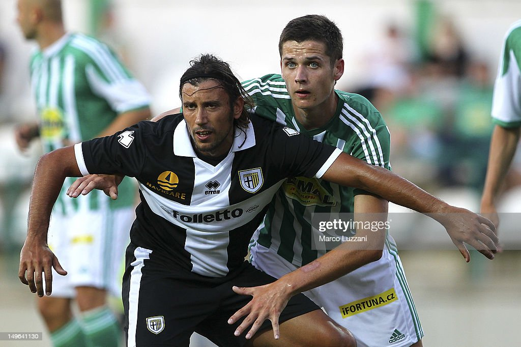 Cristian Zaccardo of FC Parma is challenged by Roman Potocny of Bohemians 1905 during the pre-season friendly match between Bohemians 1905 and Parma FC at FK Viktoria Stadion on August 1, 2012 in Prague, Czech Republic.