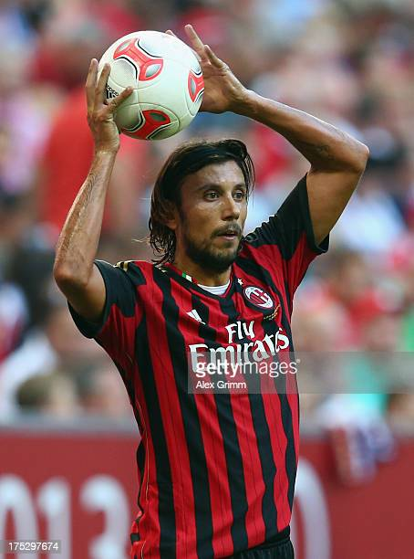 Cristian Zaccardo of Milan holds tCristian Zaccardohe ball during the Audi Cup match between FC Sao Paulo and AC Milan at Allianz Arena on August 1...