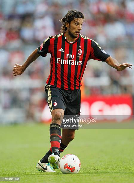Cristian Zaccardo of Milan runs with the ball during the Audi Cup 2013 third place match between FC Sao Paulo and AC Milan at Allianz Arena on August...